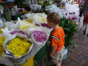 Flower market in Hong Kong with young kids