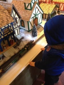 Little toy trains on Bainbridge Island with kids in the wintertime