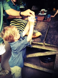 Helping to make cocoa in Costa Rica with kids