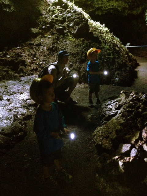 Maui with kids in a cave at the end of the road to hana